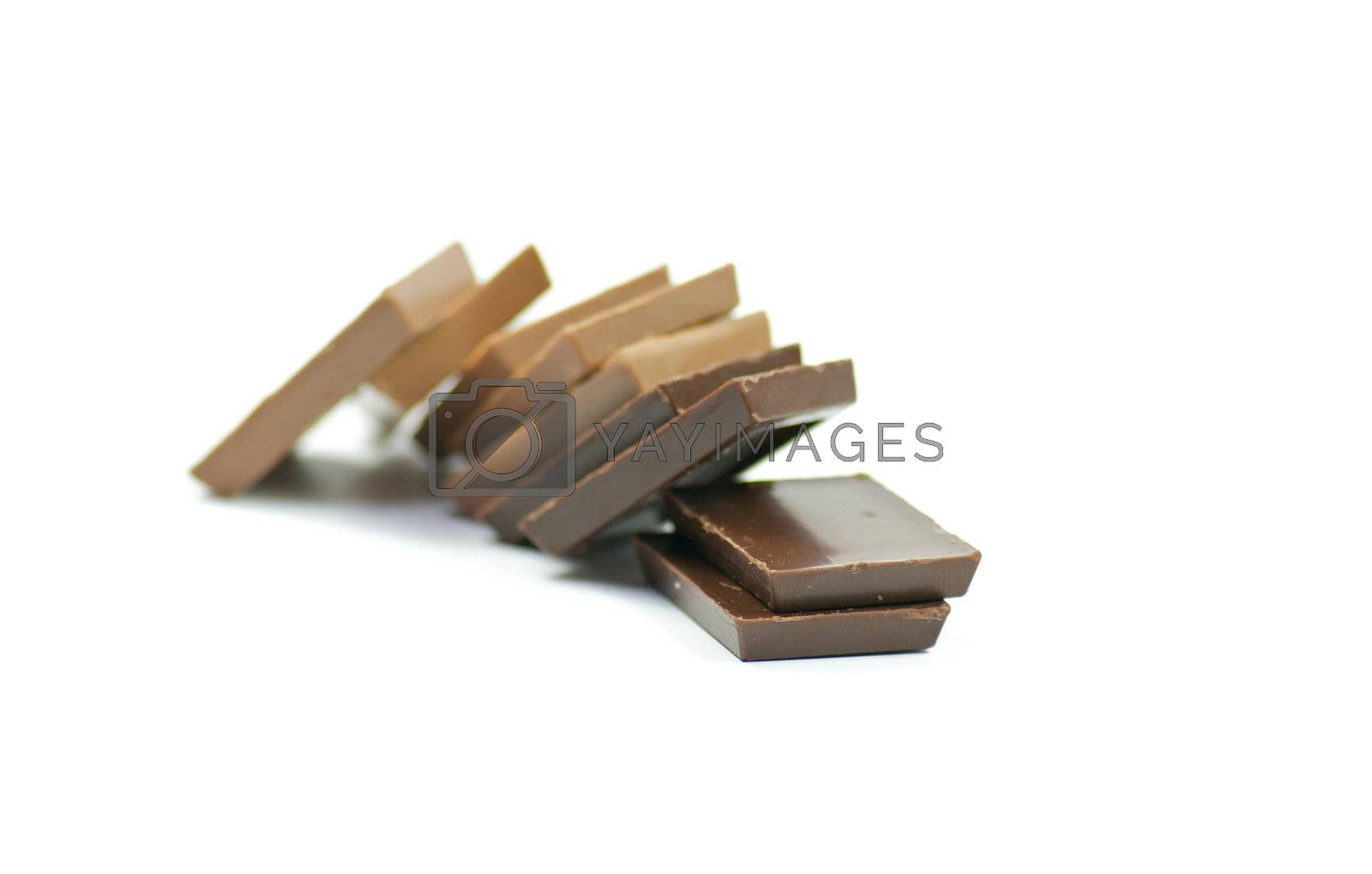 Pyramid from milk and dark chocolate on white background