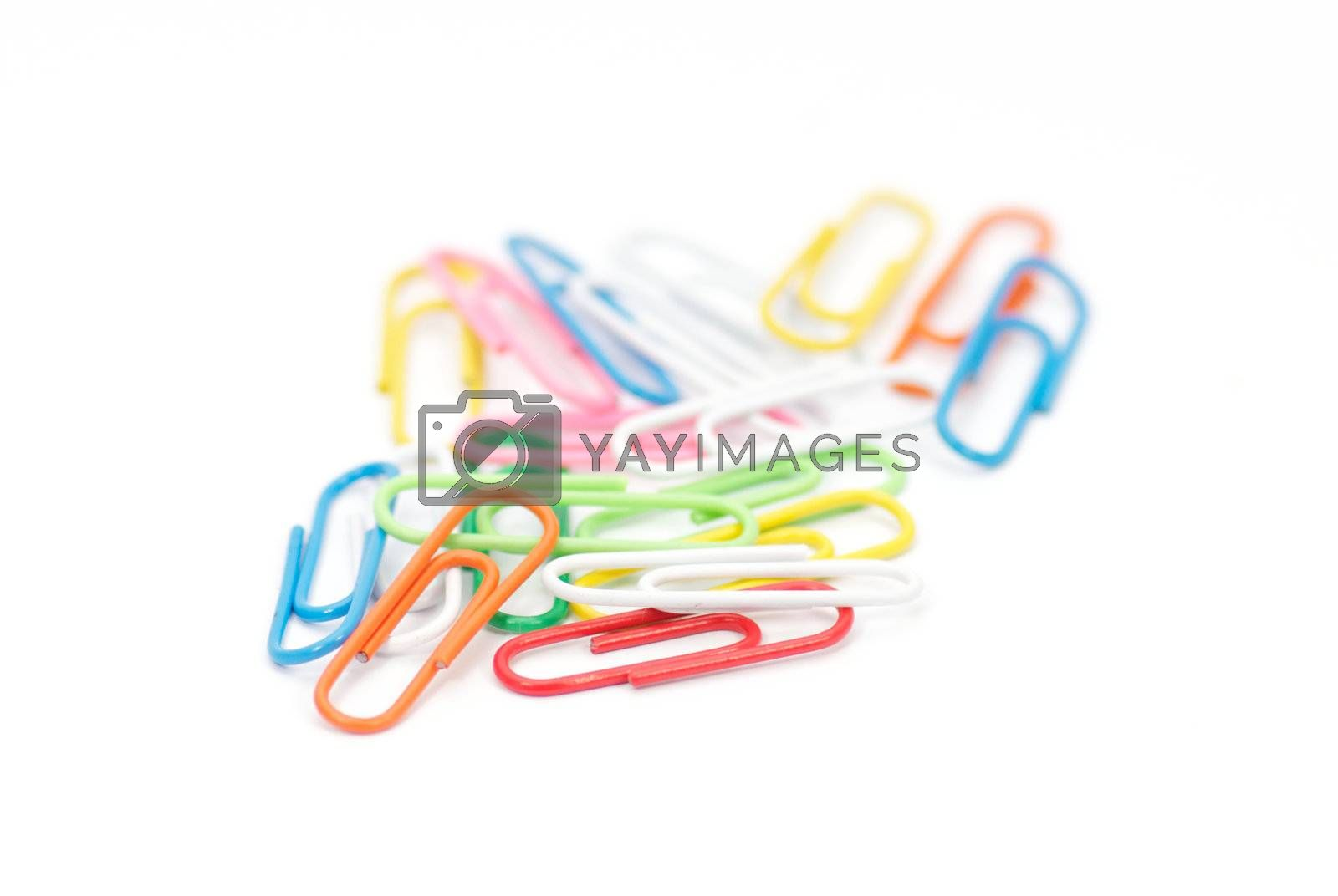 Multi colored paper clips on white background        Paper clips