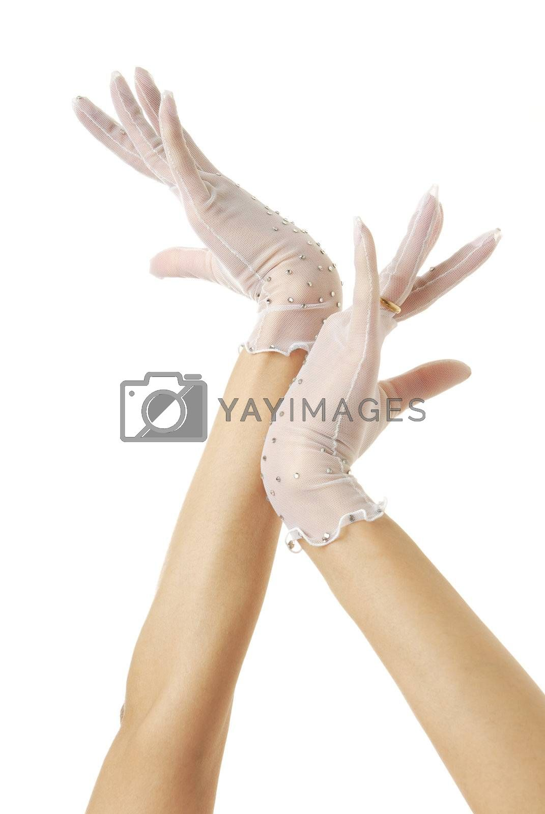 Close-up photo of elegant bride hands in gloves with wedding ring
