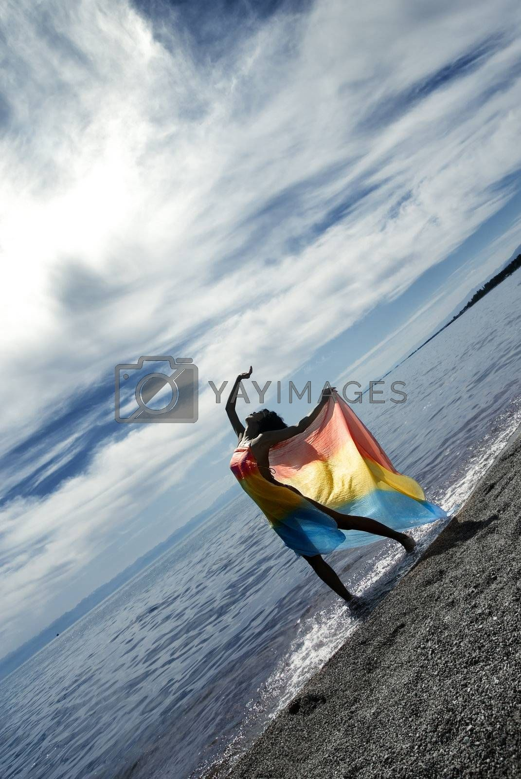 Lady making relaxation via the dance on a sea