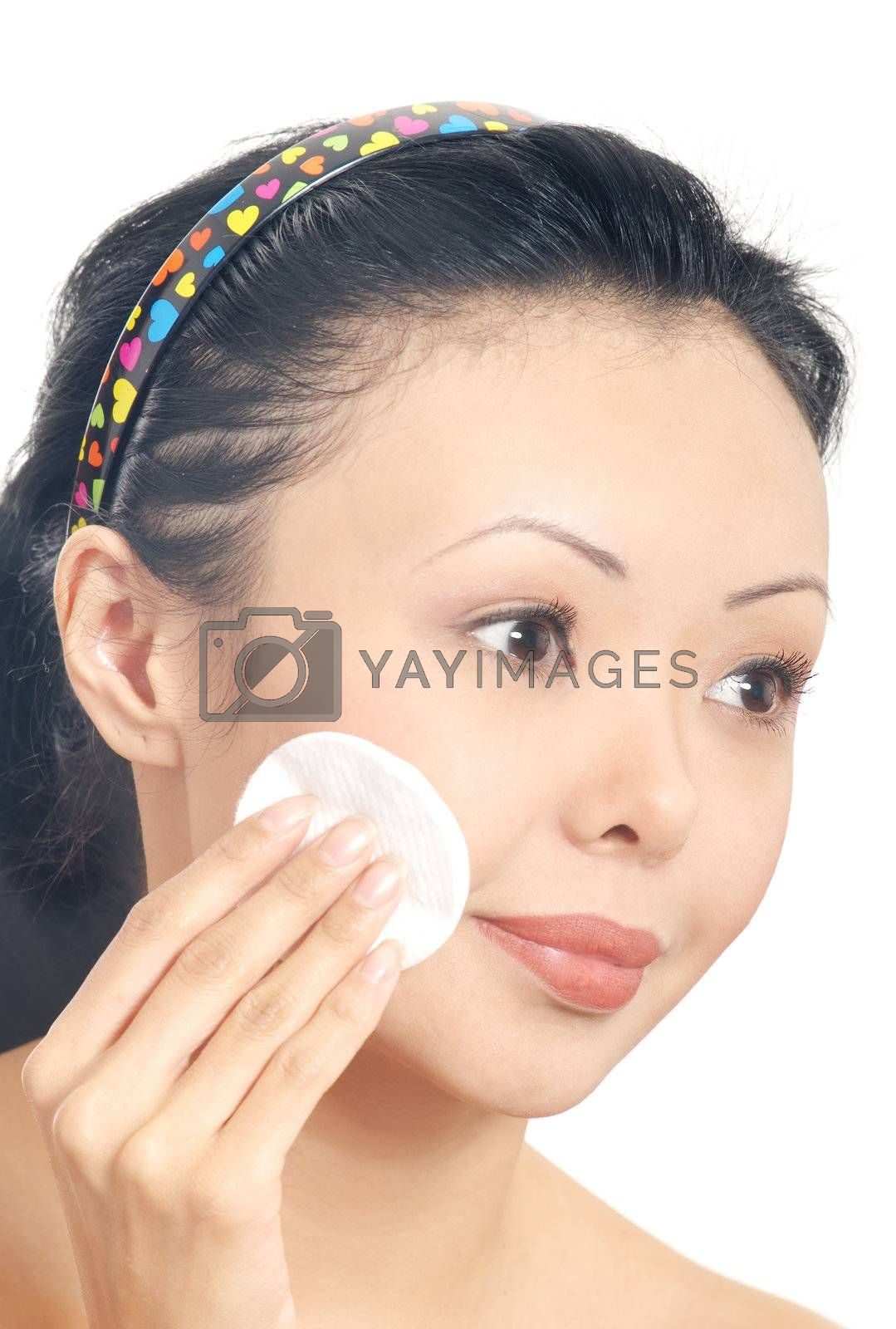 Sensual photo of the young model with cleaning sponge