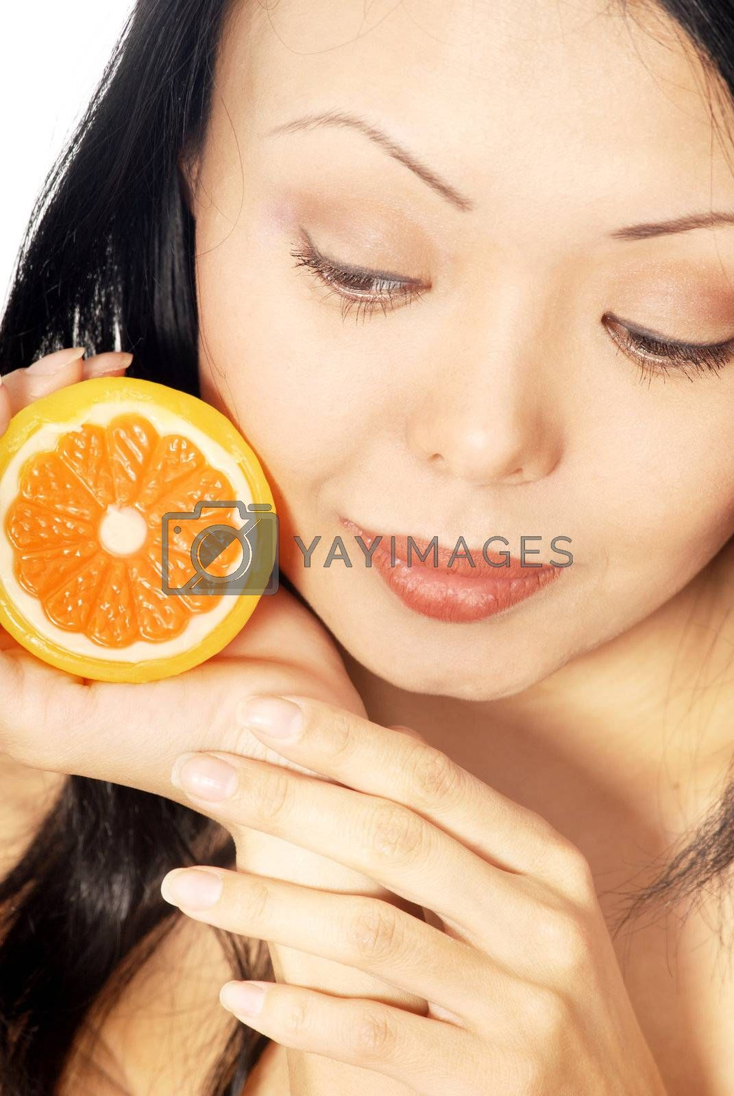 Close-up photo of pretty woman with fresh lemon
