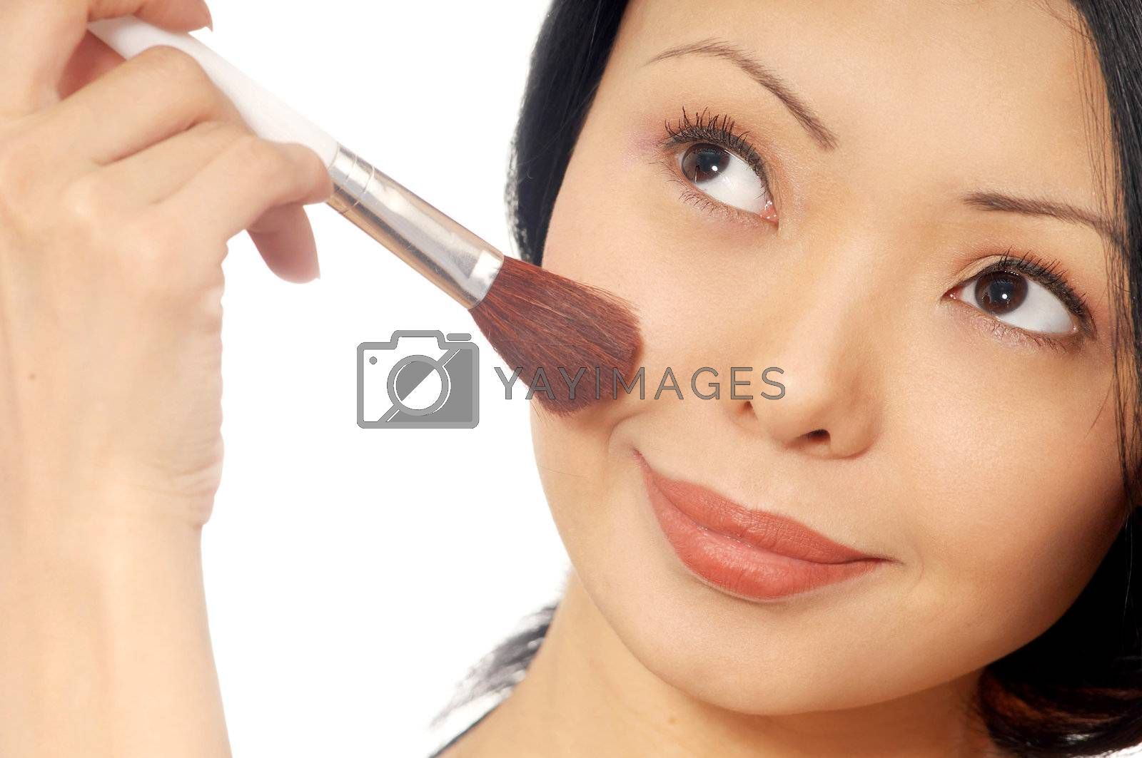 Photo of the smiling woman with face-powder brush