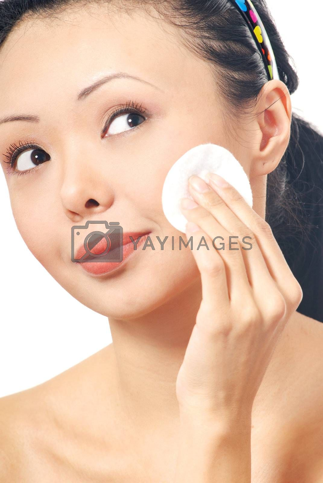 Brunette with cleaning pad on her face