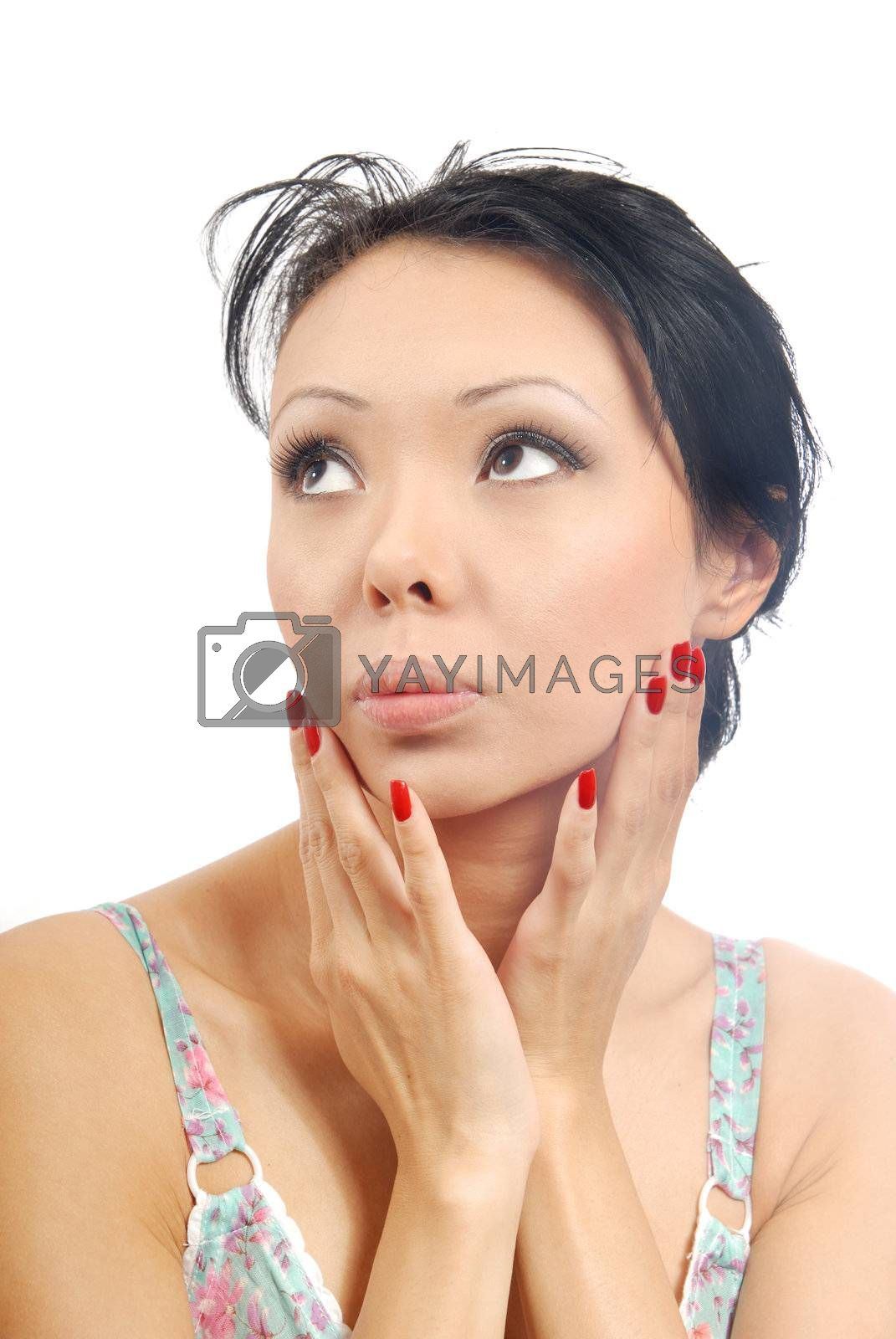 Sensual photo of the brunette on the white background
