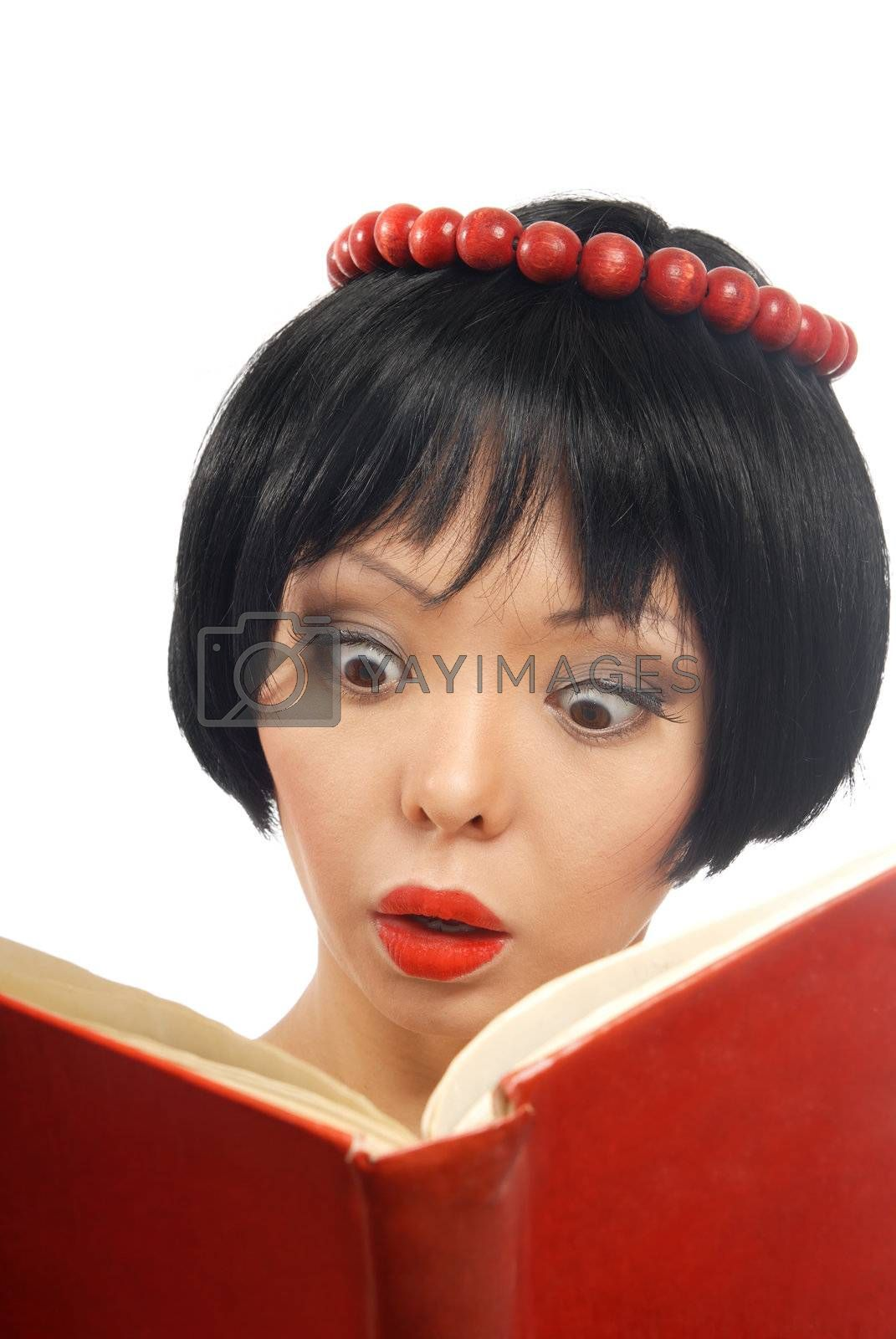 Emotional photo of the pretty model reading the red book