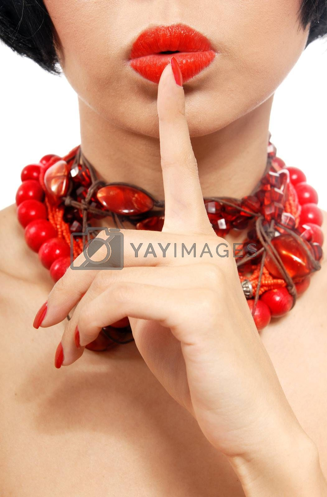 Woman in red chaplet with finger on her lips
