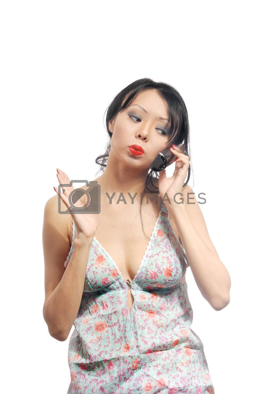 Angry and nervous woman debating via telephone with somebody