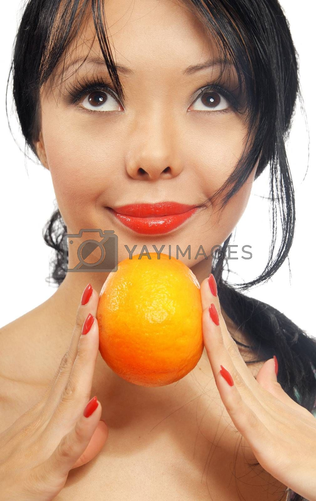 Portrait of smiling woman holding a fresh orange