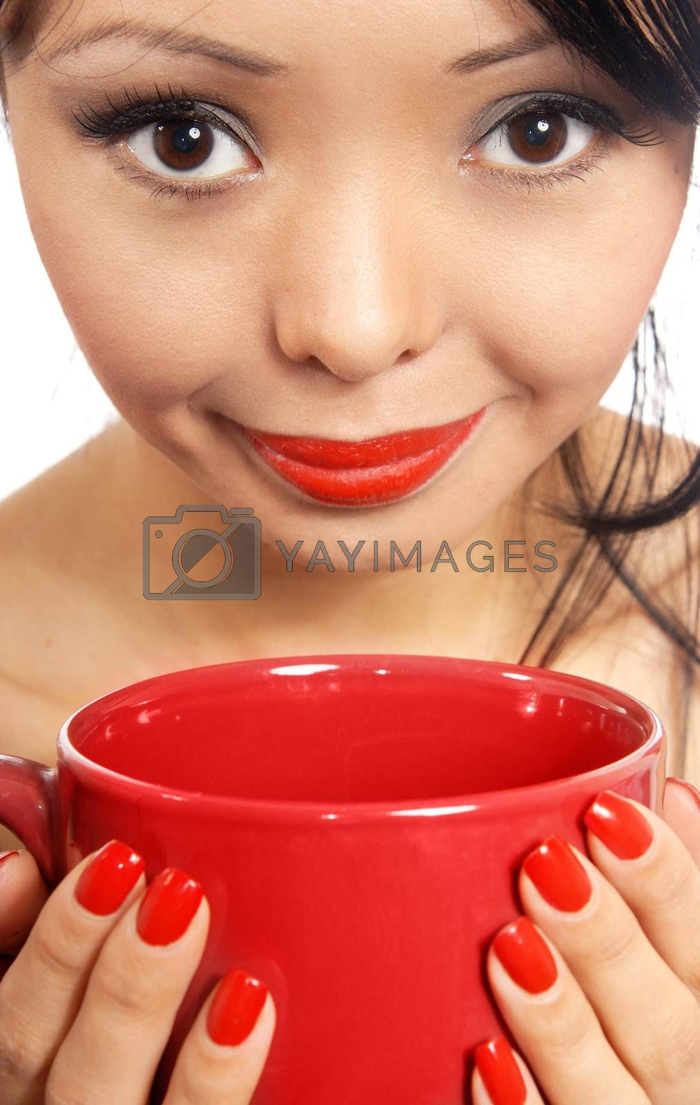 Smiling model holding red cup with drink or eat