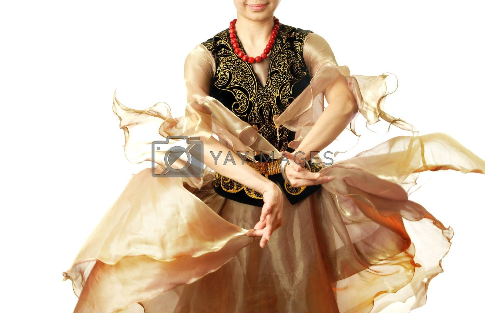 Lady in traditional oriental costume acting Uzbek dance