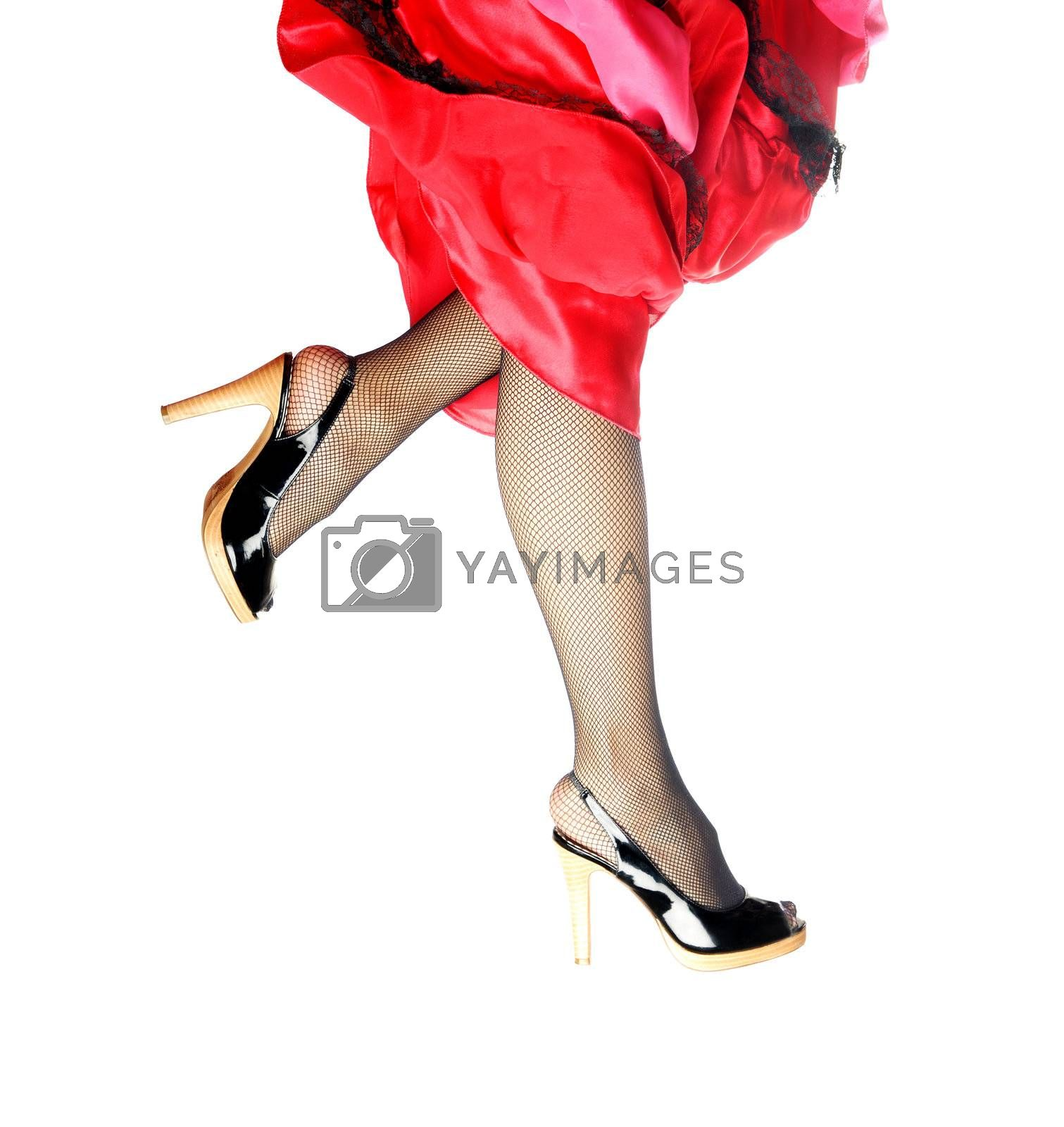 Woman legs running and dancing on a white background