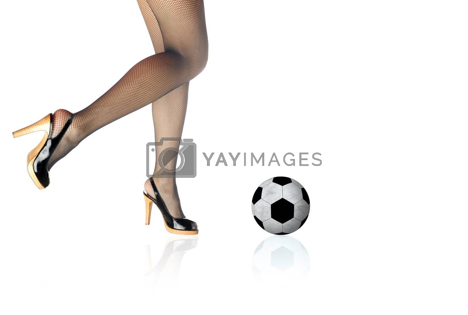 Graceful legs and football on a white background