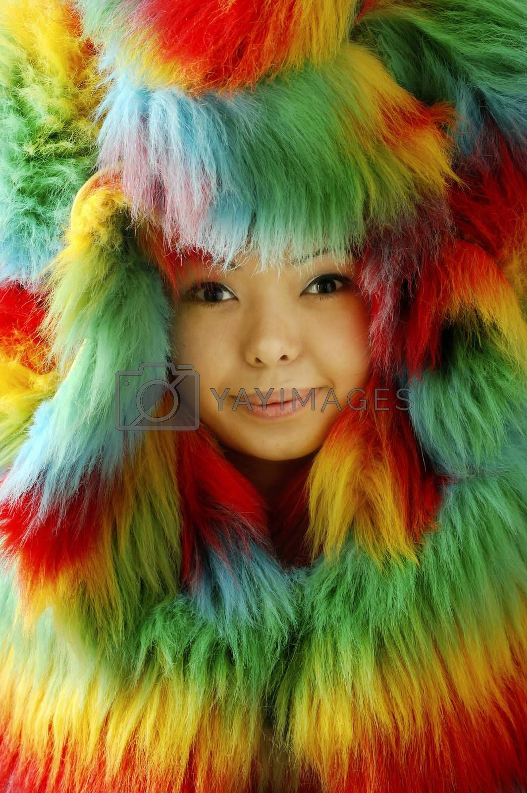 Smiling lady in colorful fur