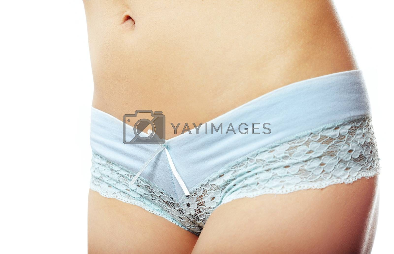 Woman waistline on a white background with blue panties