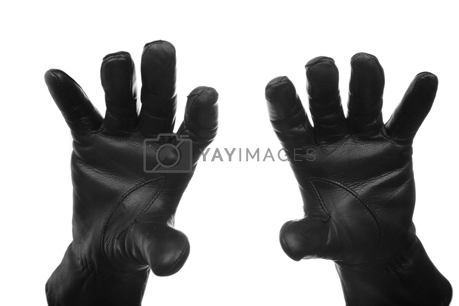 Hands of the criminal person in black leather gloves