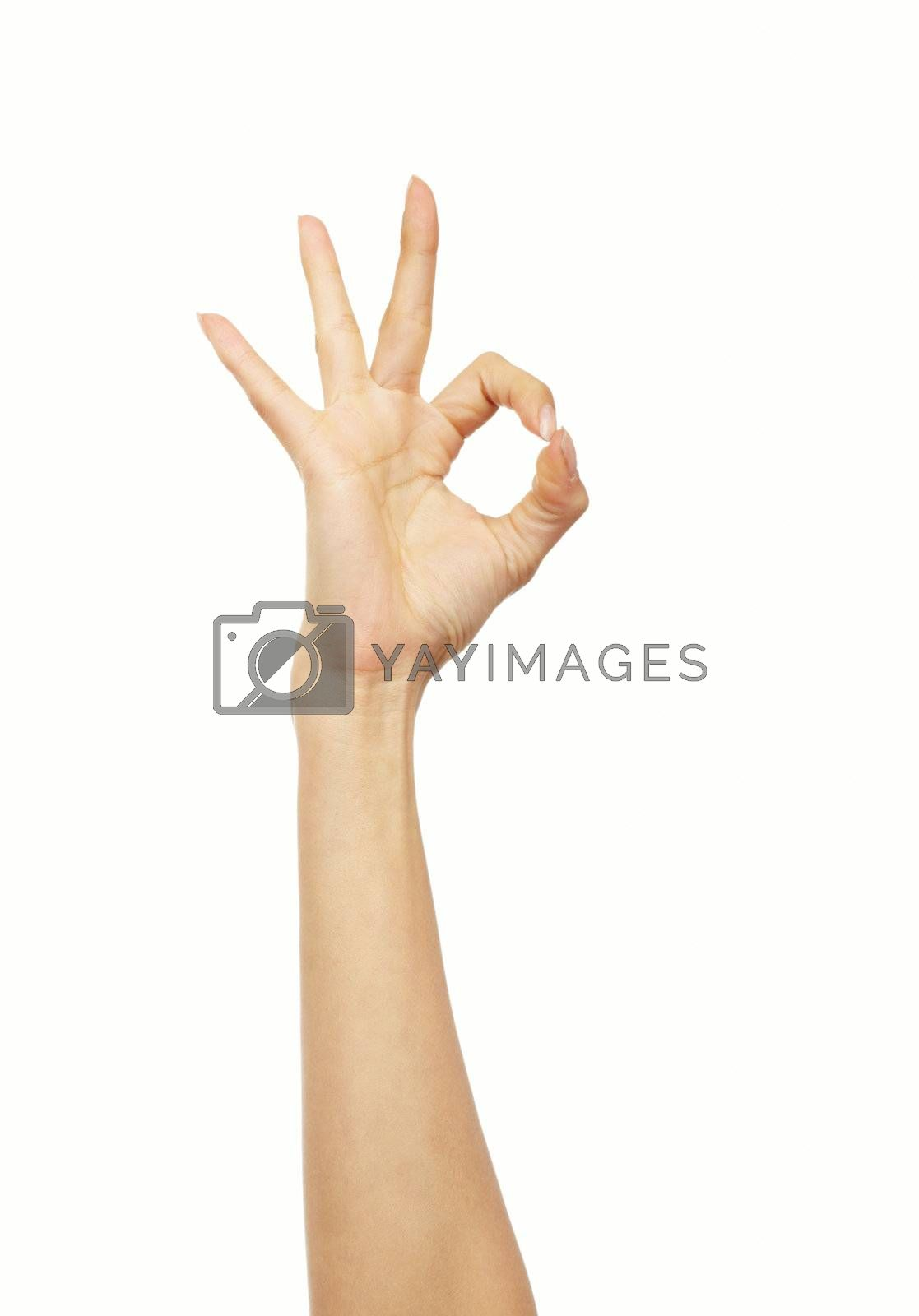 Human hand making OK sign