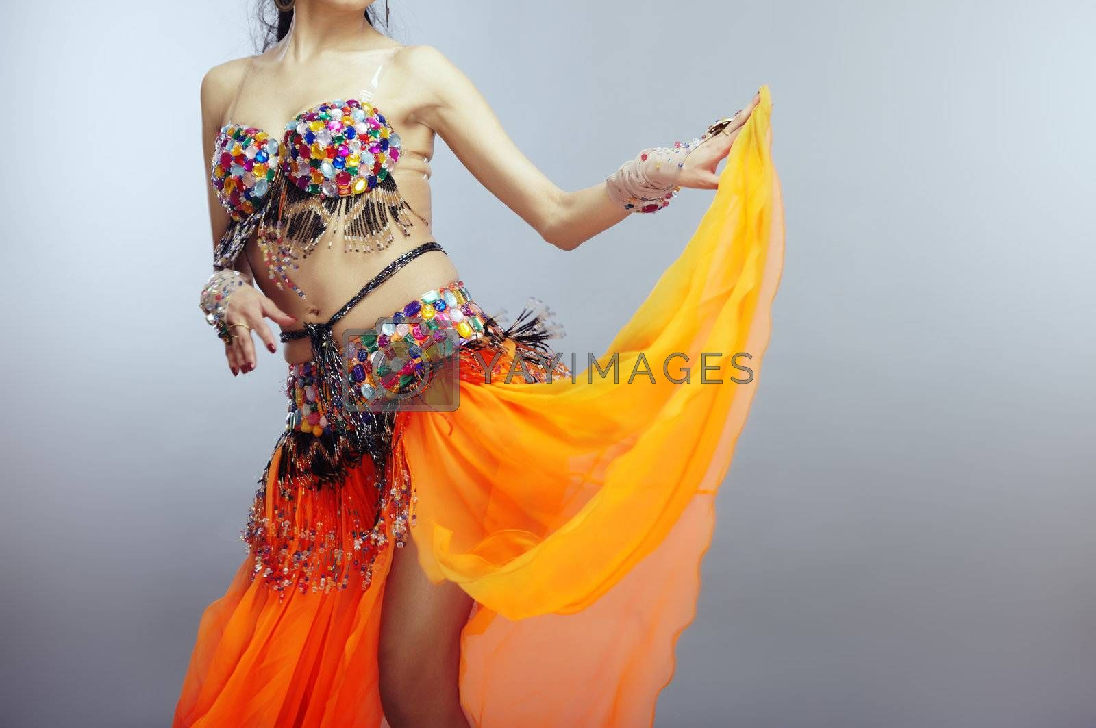 Body of the belly dancer in traditional costume
