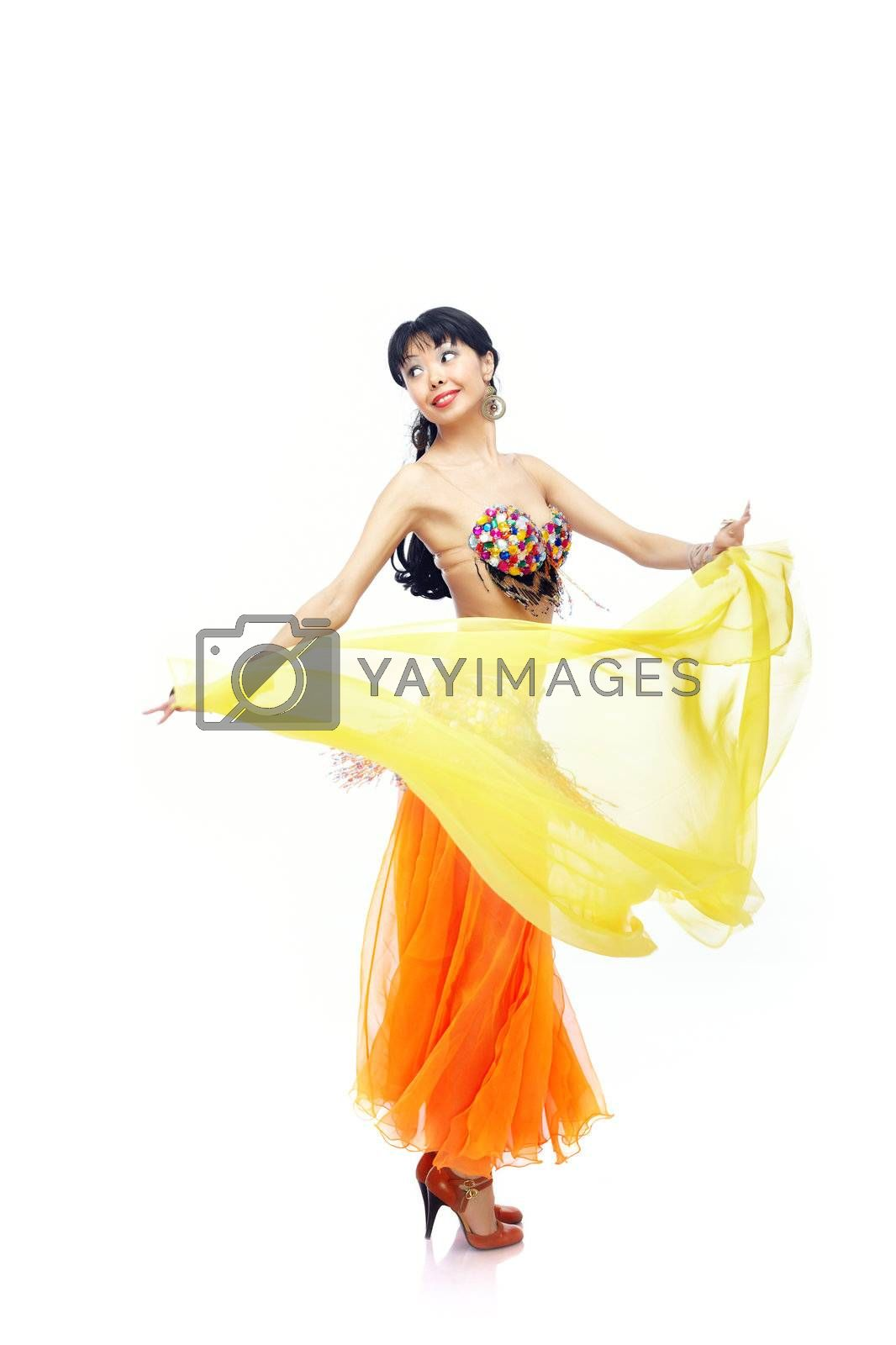 Beautiful lady dancing belly dance with yellow fabric