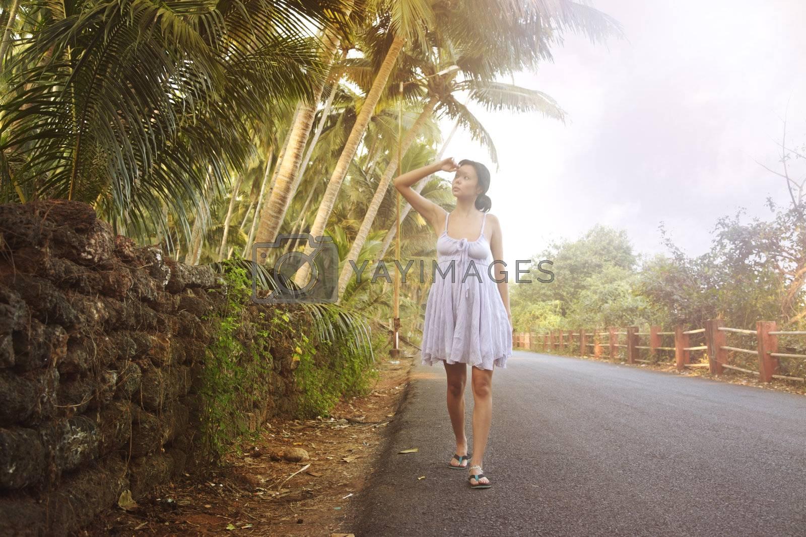 Lady walking in India street