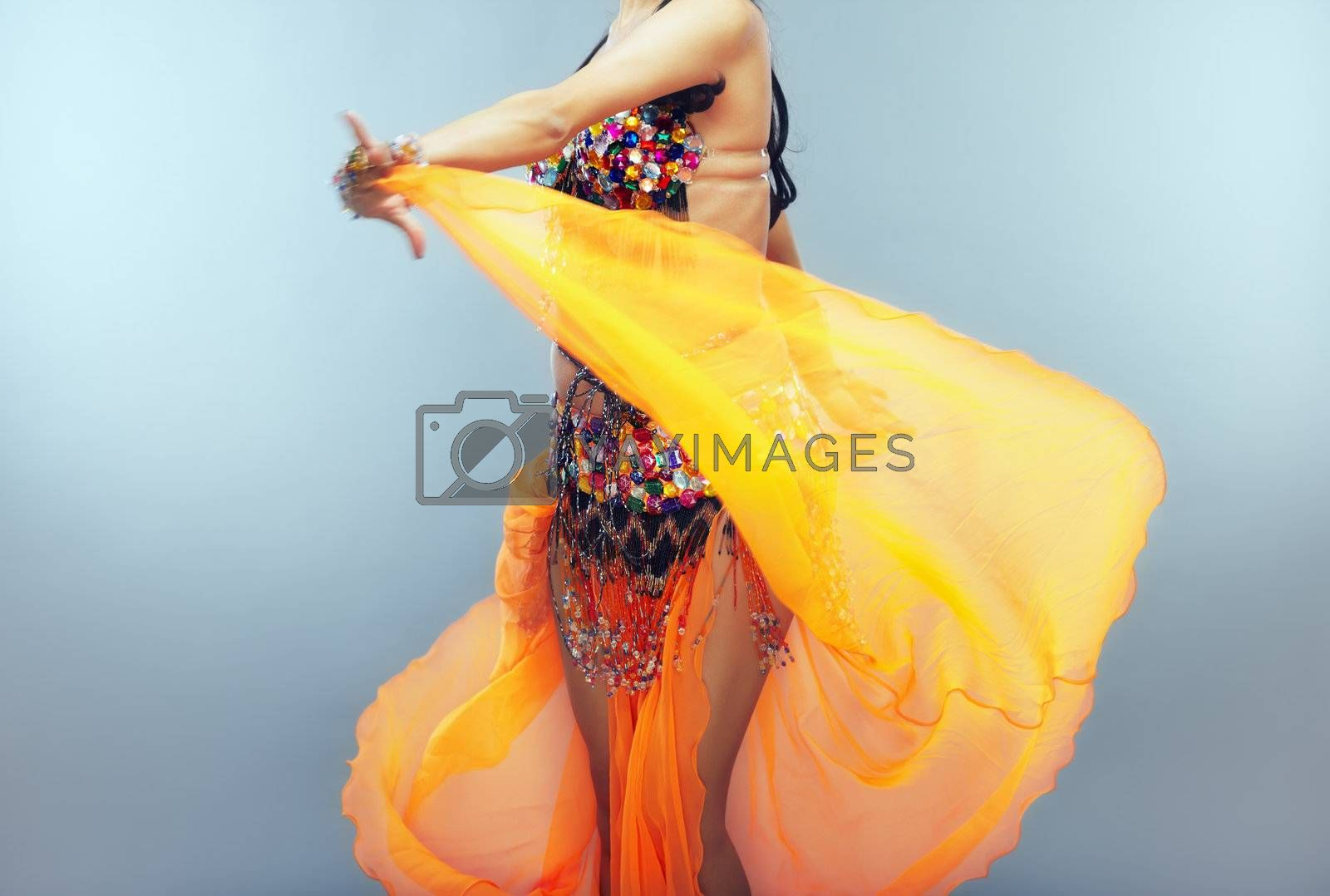 Dancing belly dancer moving her traditional dress