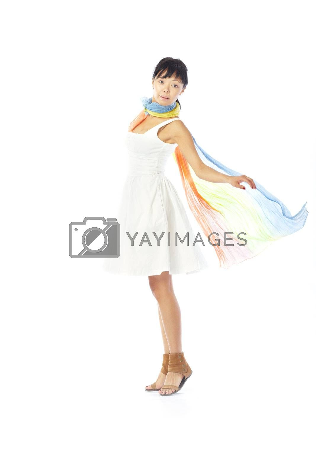 Elegant lady in the stylish dress and scarf dancing on a white background