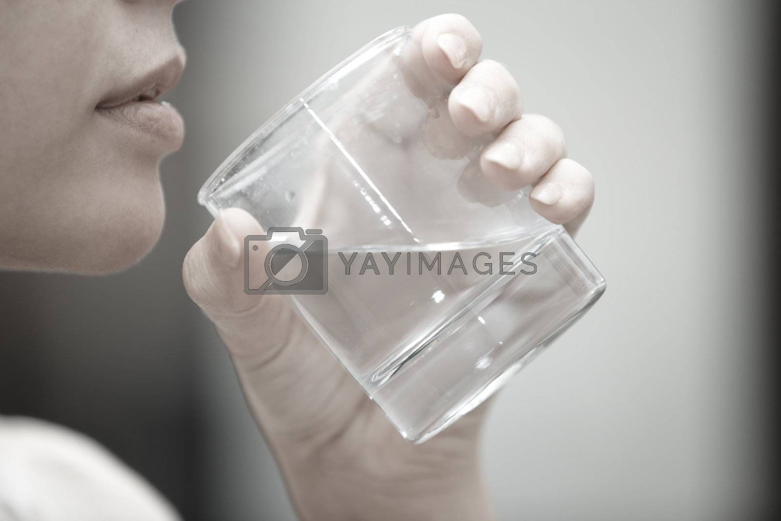 Woman holding glass with potable water