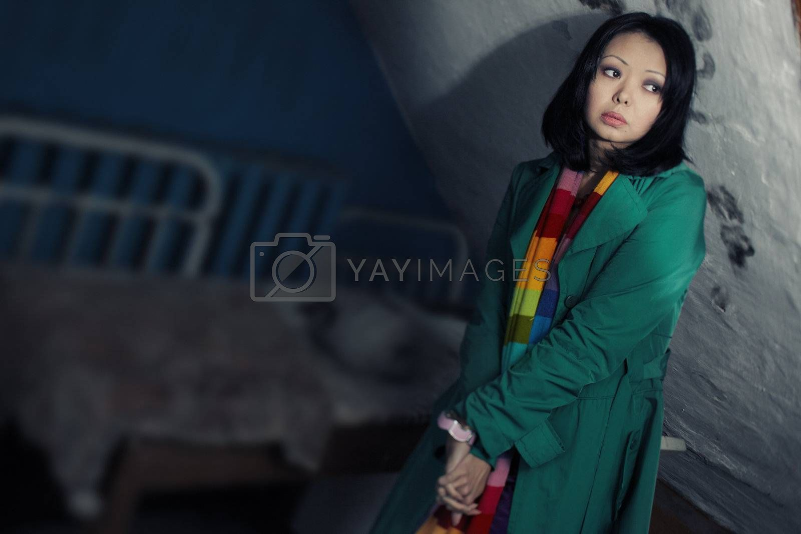 Sad stylish woman indoors. Special defocus effect taken from tilt-shift lens