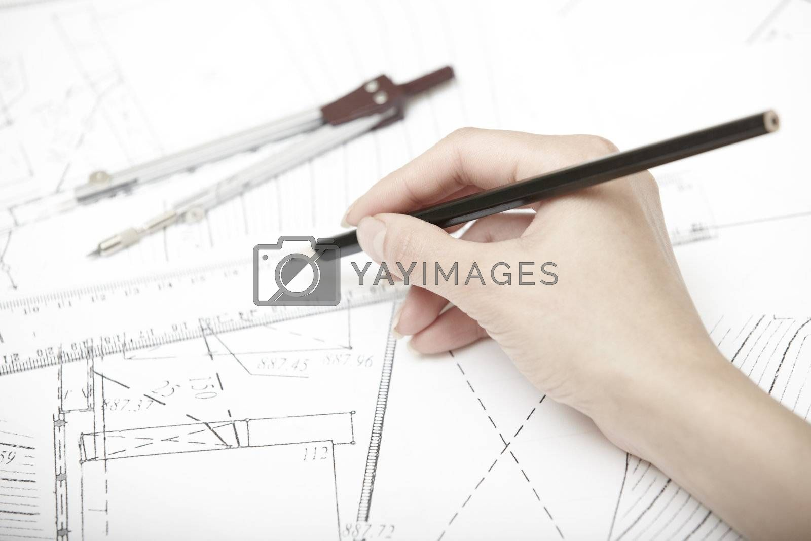 Hand of engineer working on a construction plan