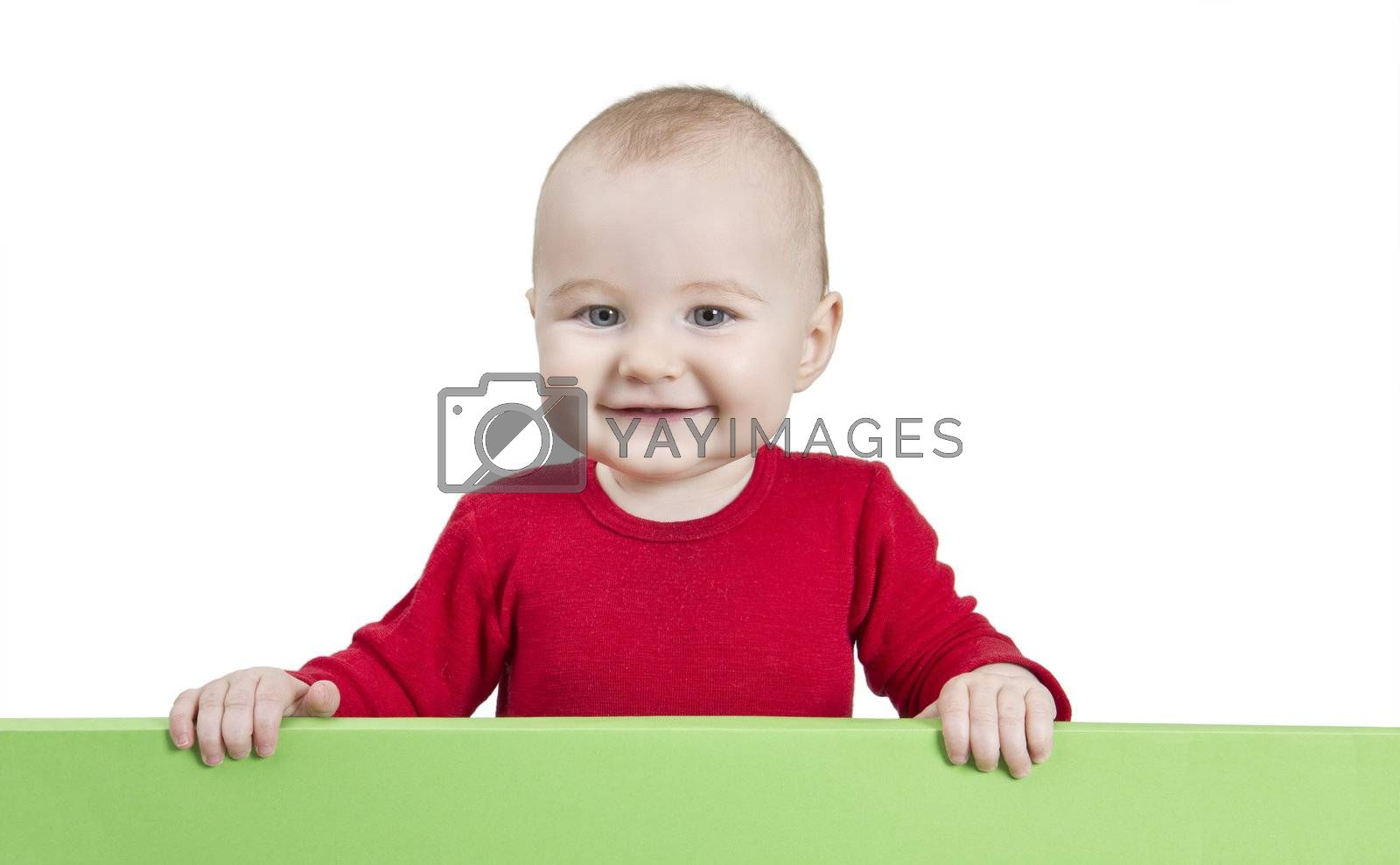 young child holding green shield. isolate on white background