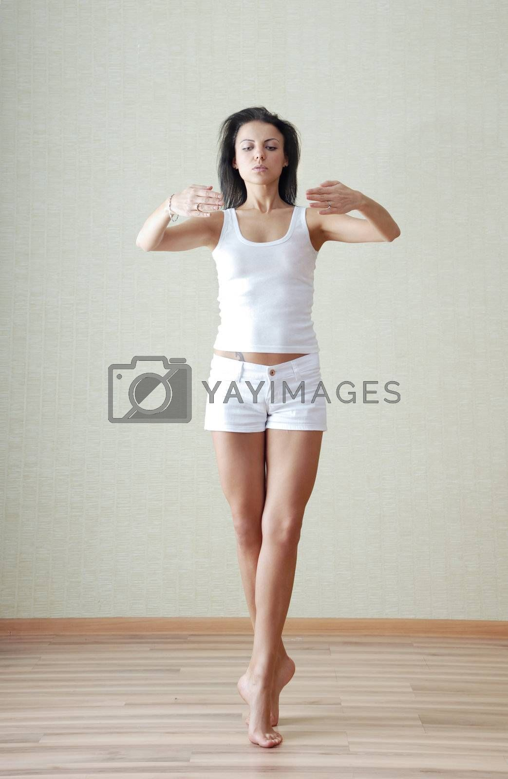 Standing woman making yoga exercise