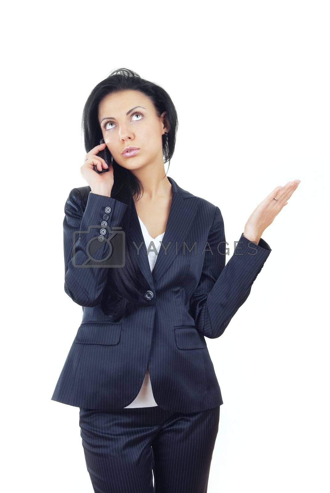Businesswoman talking via cell phone on a white background