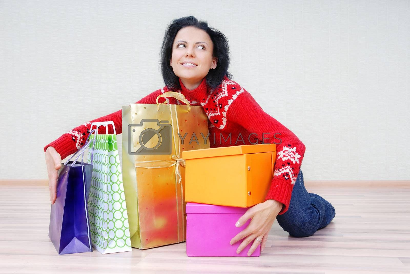 Glad lady indoors with gift shopping presents