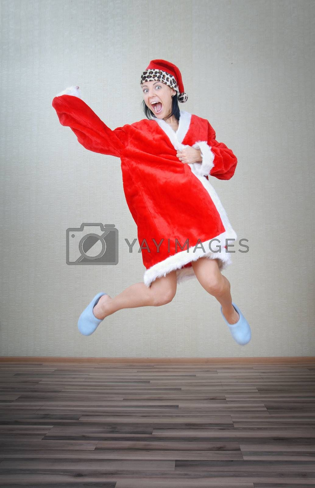 Crazy lady jumping indoors in Santa costume