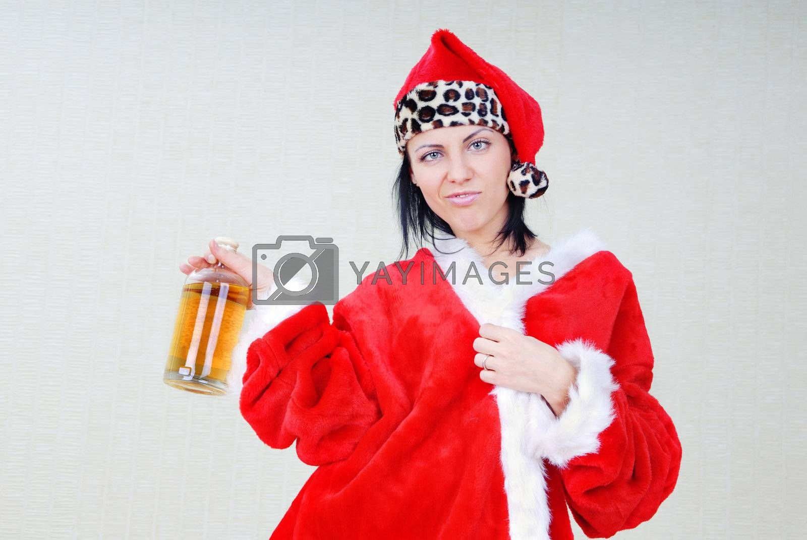 Drunken woman in Santa Claus costume with alcohol beverage