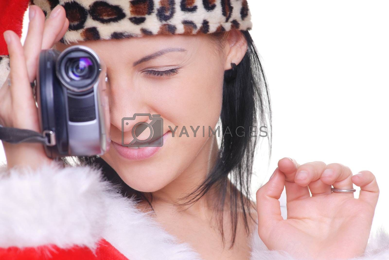 Attractive lady in Santa costume holding video camera