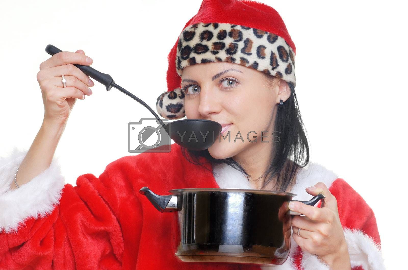 Pretty woman cooking the soup in Santa Claus dress