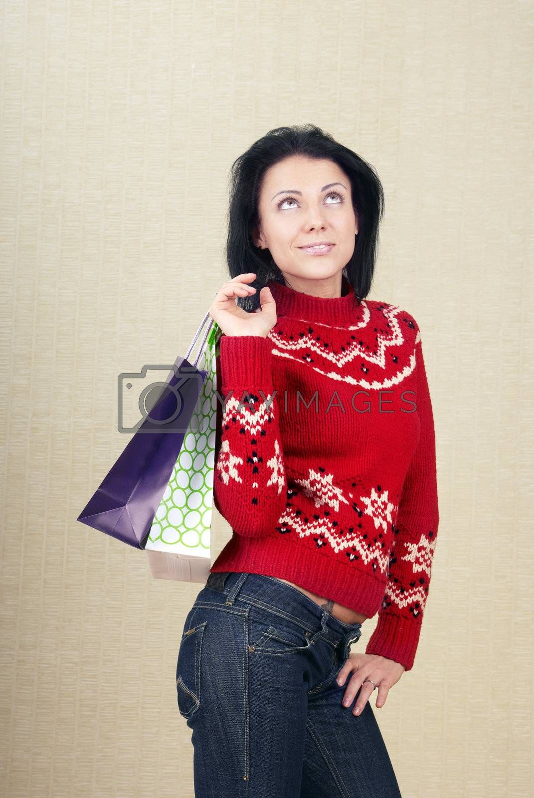 Smiling lady with shopping bags indoors