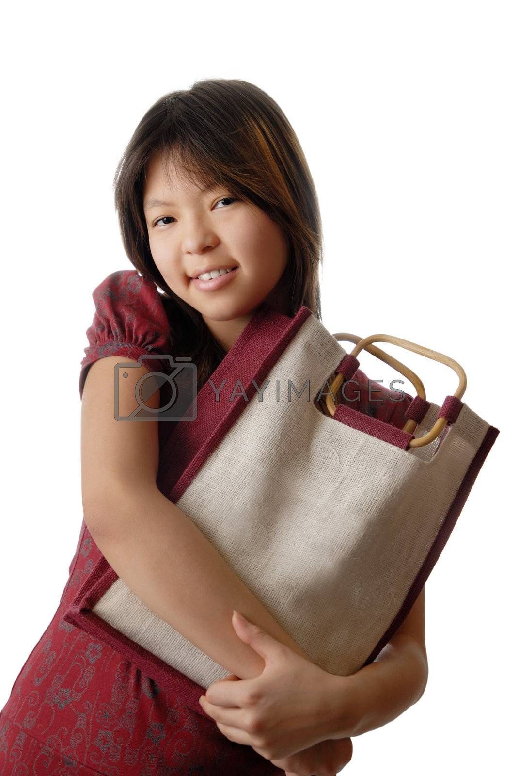 Young model with shopping bag in hands