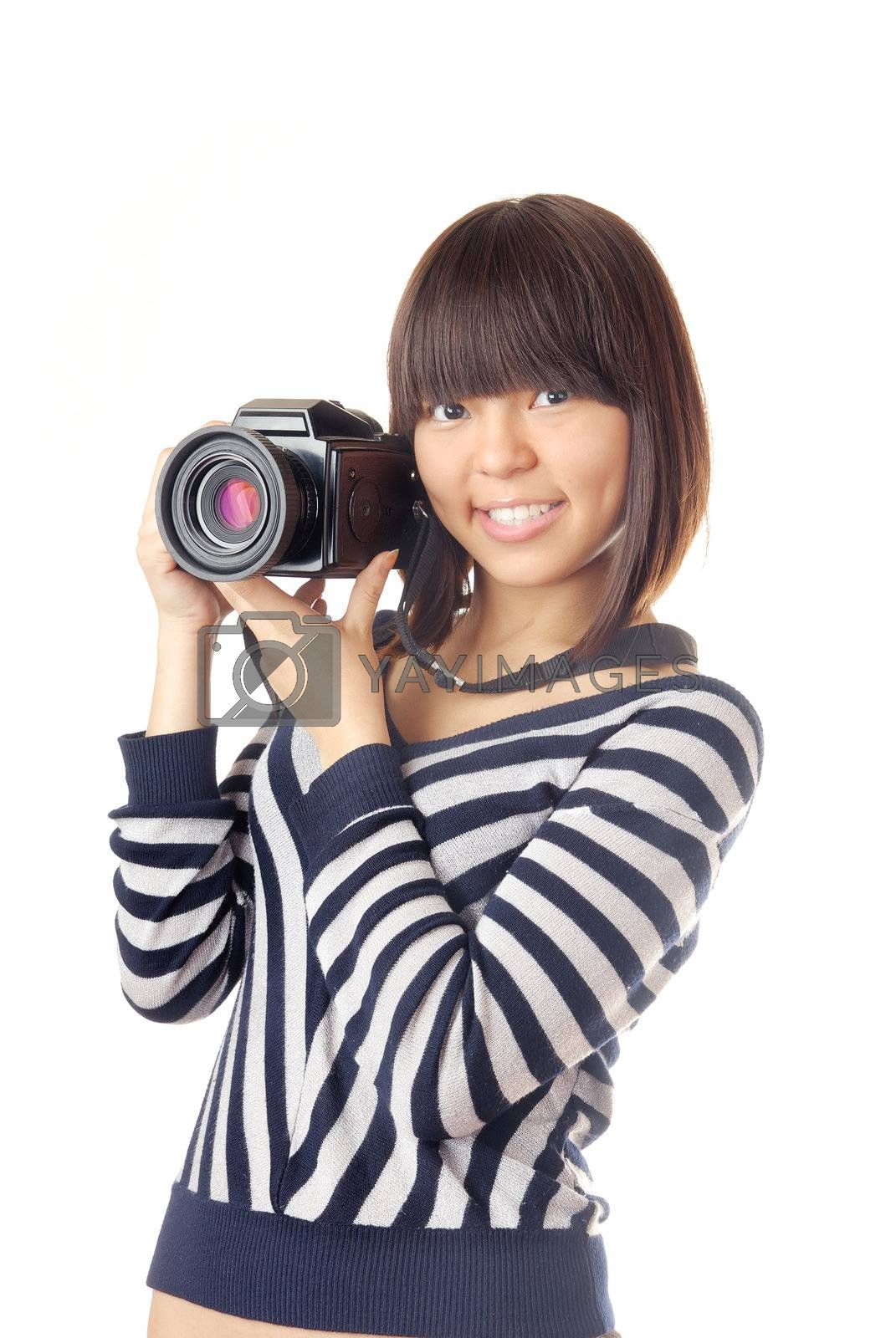 Young lady holding a digital photo camera