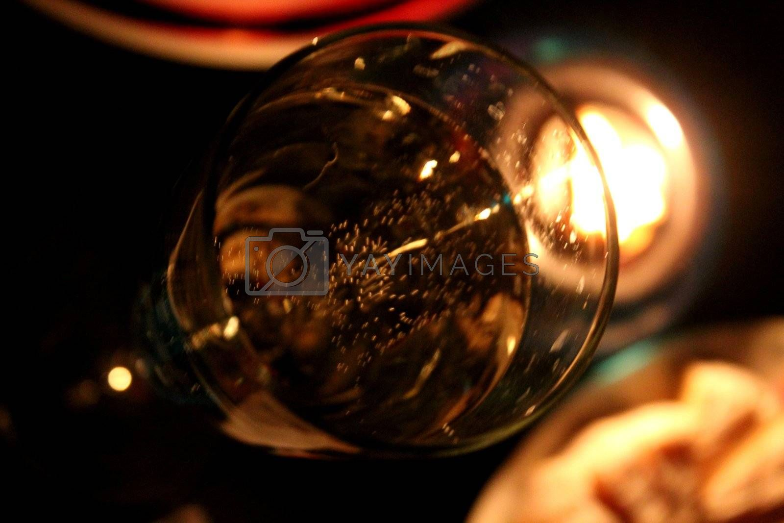 bubbly glass of champagne by candlelight, food still life