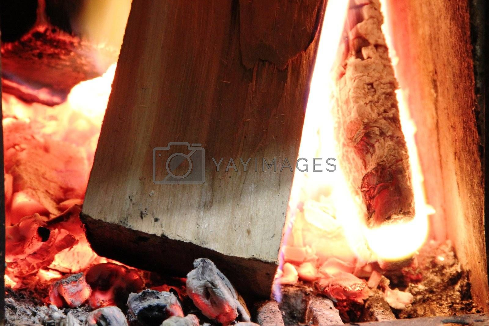 Beautiful wood burning in the fireplace red coals