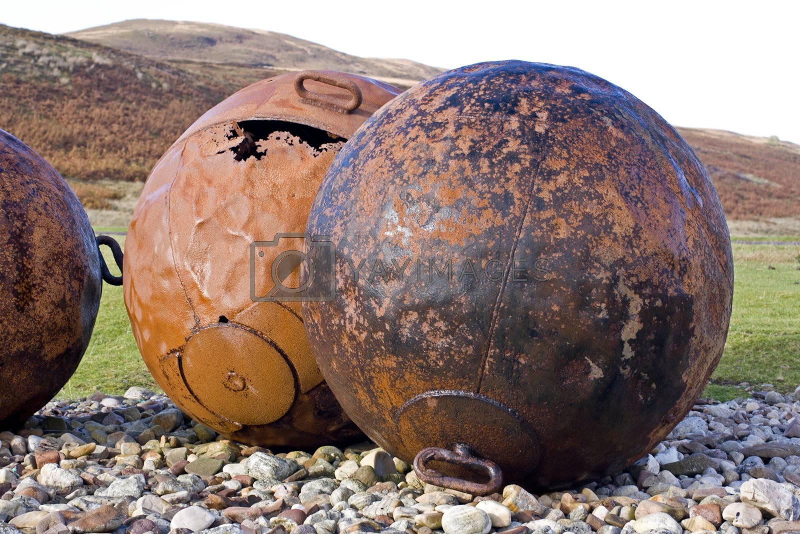 big balls at scottish coast. old buoys