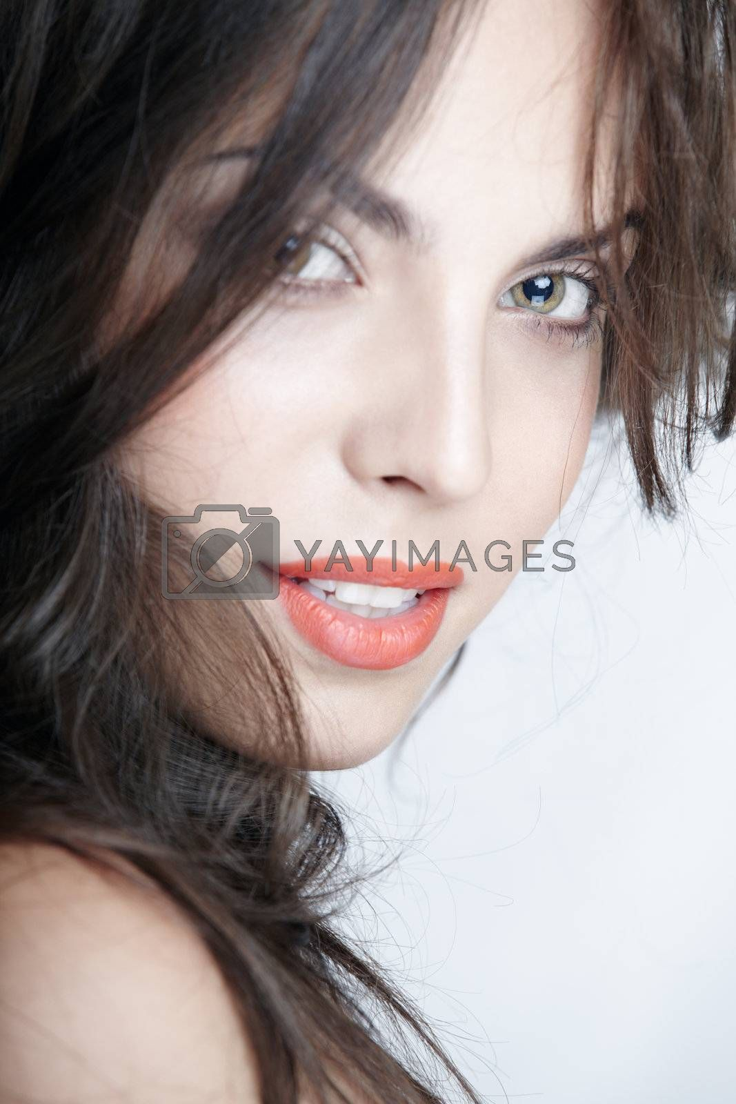 Beautiful lady with perfect makeup on a studio background