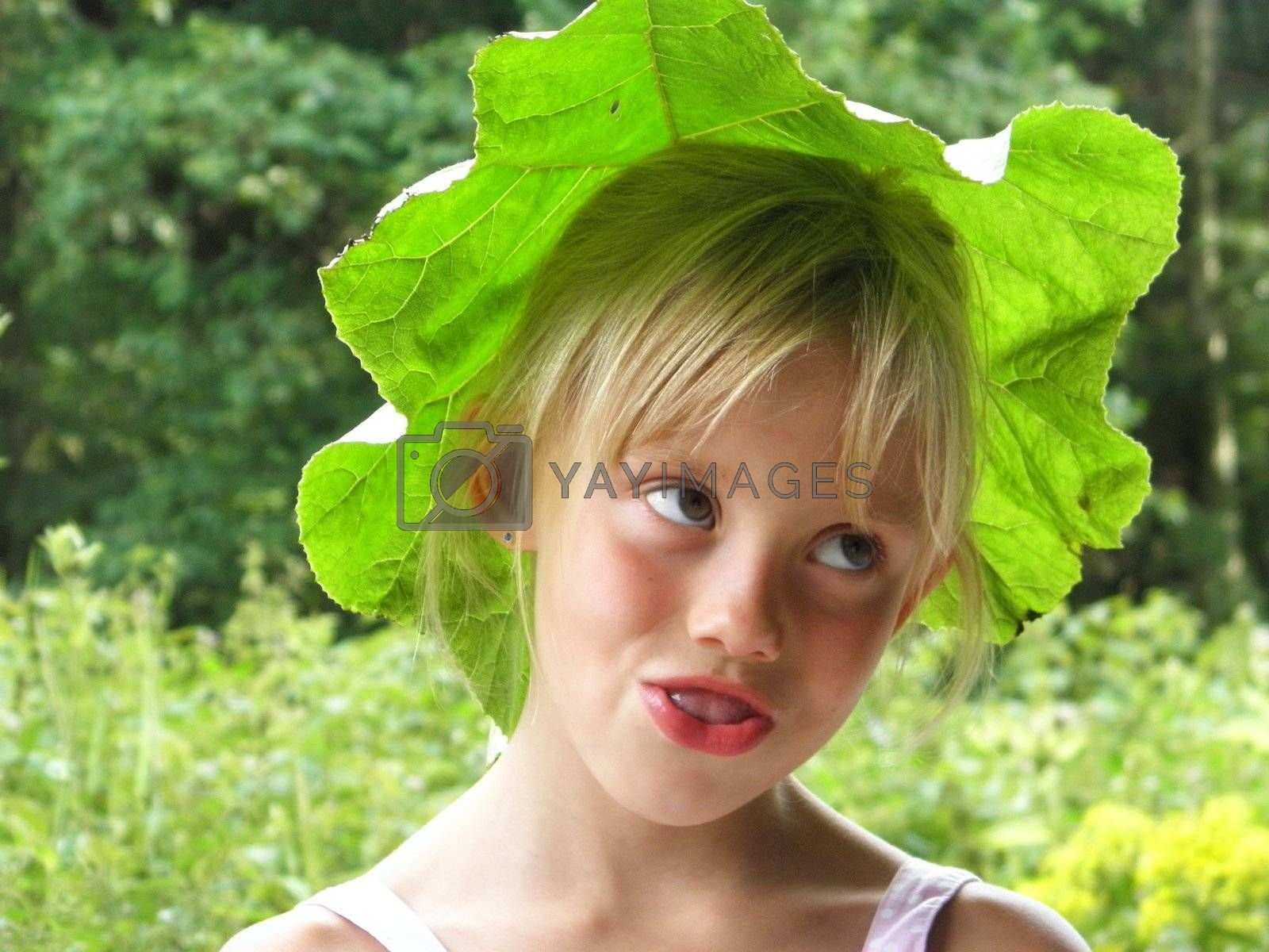 Photo of a blonde girl with a Green Hat from a sheet