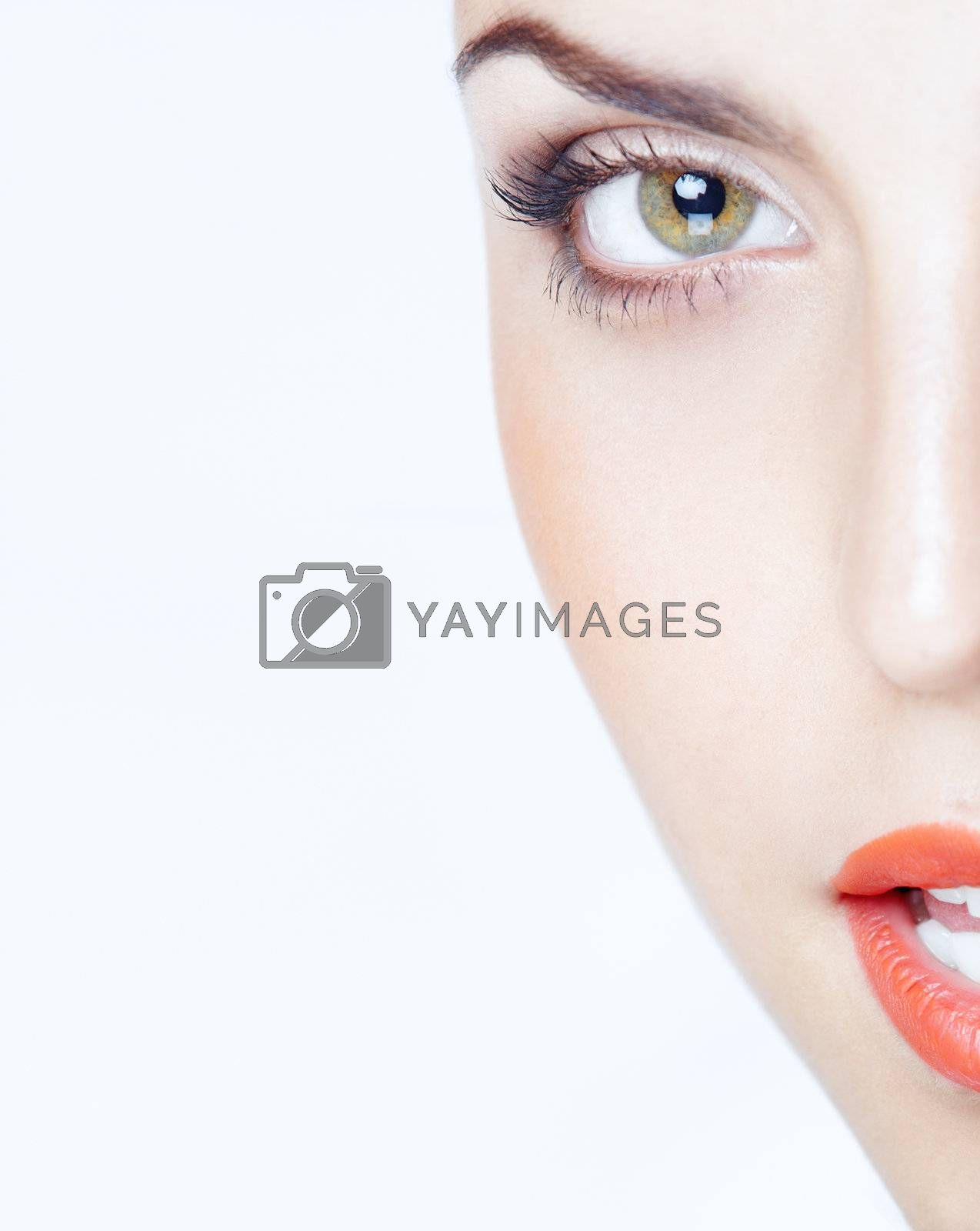 Beautiful lady on a blue studio background. Close-up colorful portrait