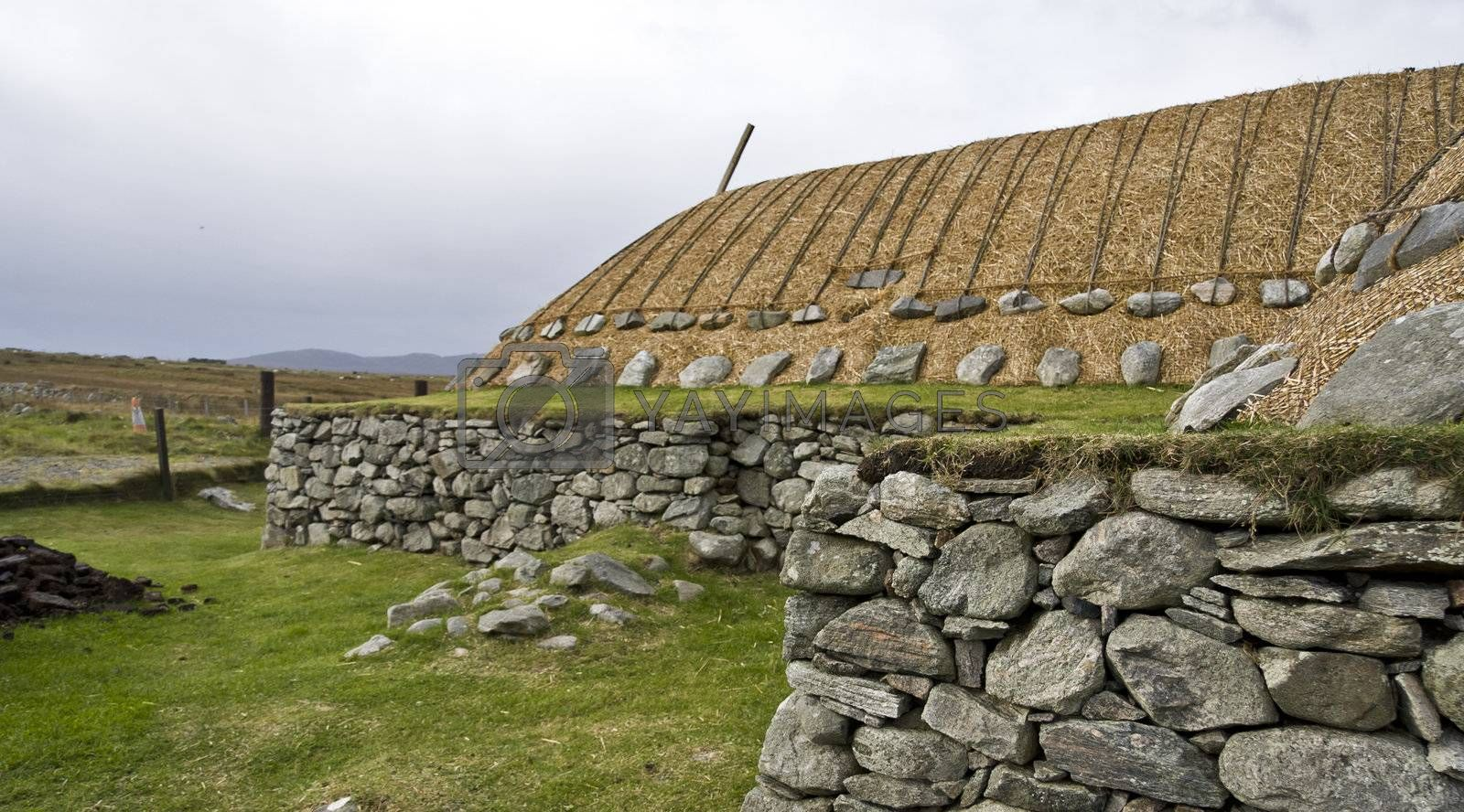 traditional scottish house with stones and reed
