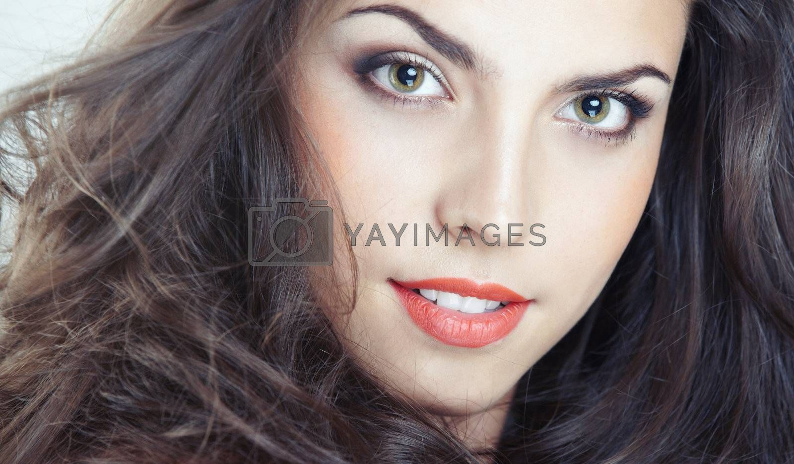 Beautiful lady with perfect makeup. Studio photo