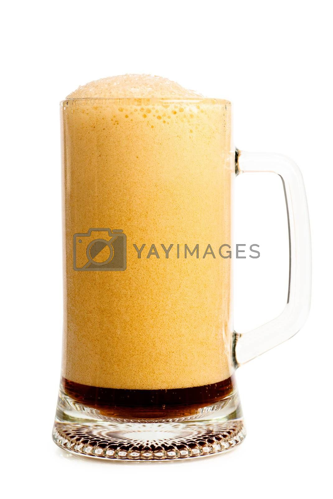 Dark beer with froth in a glass over white background