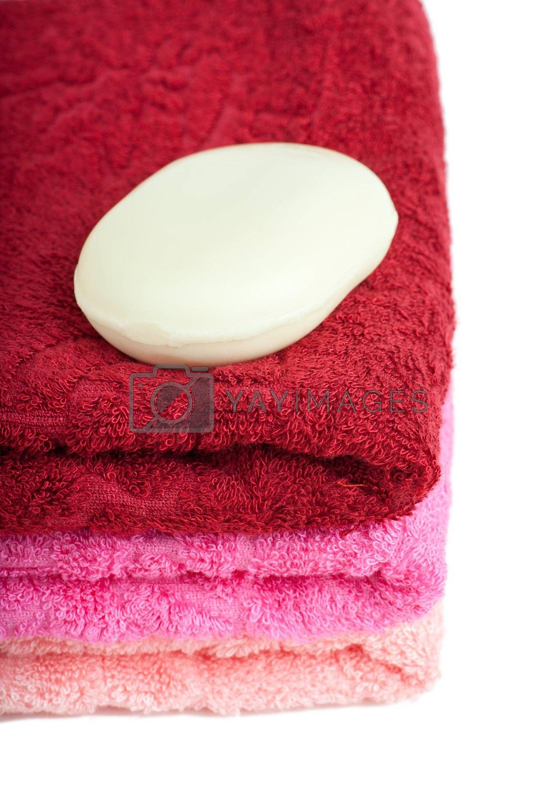 Stack of bright red and pink towels over white background